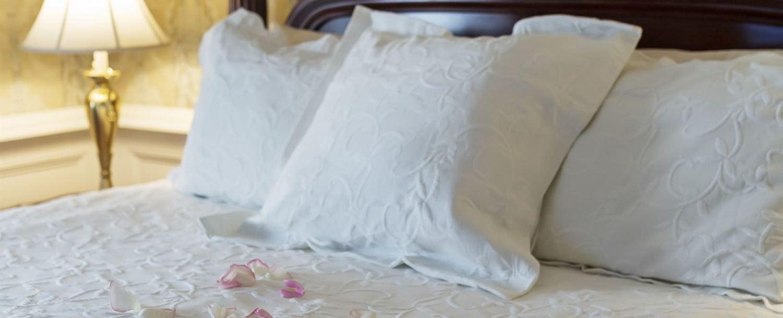 Lipscomb Room Bed Closeup with Rose Petals